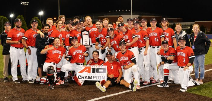 Baseball team with A-10 Champion sign