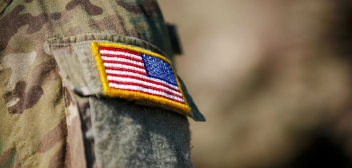 Soldier with American flag on uniform