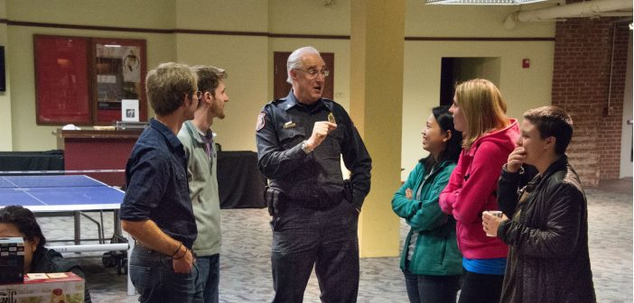 Police Chief Todd Sigler stands with Davidson students