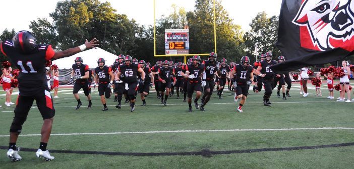 Davidson football team running on field