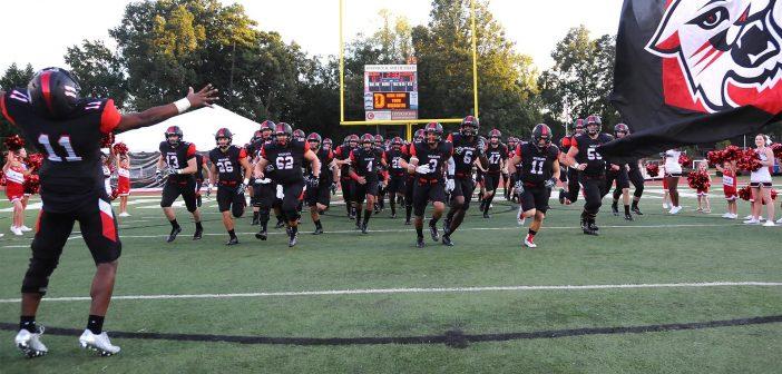 Davidson football team running on field
