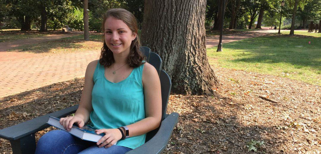 Hannah Stadtler '18 sitting on campus