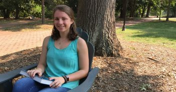 Hannah Stadtler '18 sitting on campus