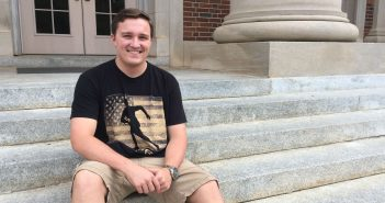 Cody Little '20 on steps of Chambers Building
