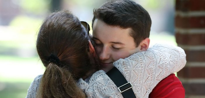 Mom and Son embrace at Orientation 2017