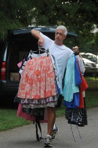 father carrying clothes
